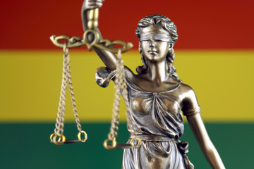 Symbol of law and justice with Bolivia Flag. Close up.