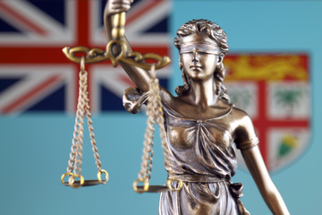 Symbol of law and justice with Fiji Flag. Close up.