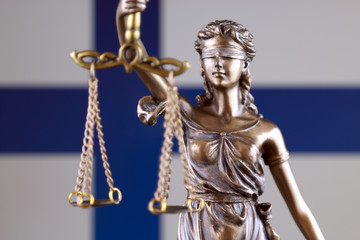 Symbol of law and justice with Finland Flag. Close up.