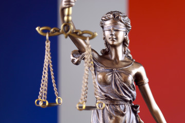 Symbol of law and justice with France Flag. Close up.