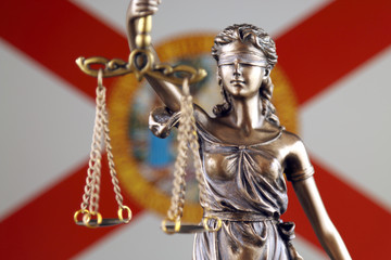 Symbol of law and justice with Florida State Flag. Close up.