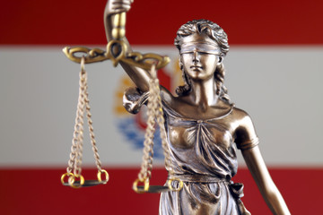 Symbol of law and justice with French Polynesia Flag. Close up.
