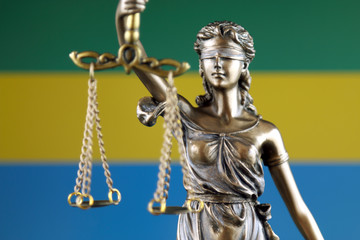 Symbol of law and justice with Gabon Flag. Close up.
