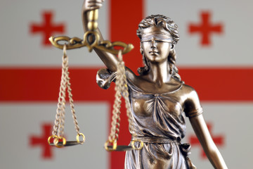 Symbol of law and justice with Georgia Flag. Close up.