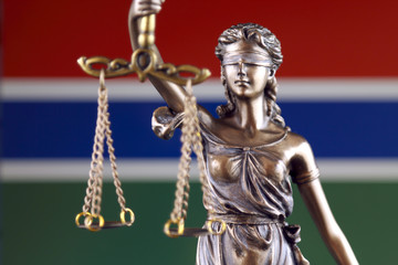 Symbol of law and justice with Gambia Flag. Close up.