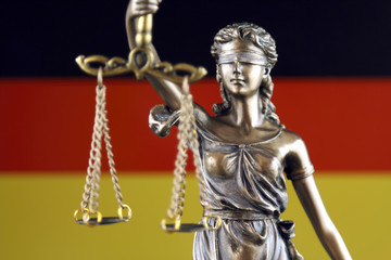 Symbol of law and justice with Germany Flag. Close up.