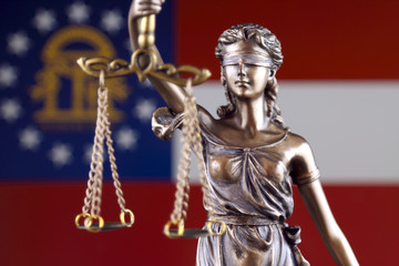 Symbol of law and justice with Georgia State Flag. Close up.