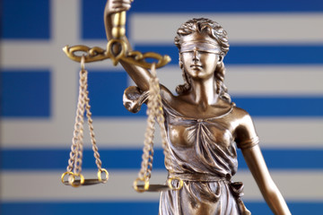 Symbol of law and justice with Greece Flag. Close up.