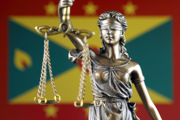Symbol of law and justice with Grenada Flag. Close up.