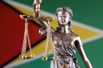 Symbol of law and justice with Guyana Flag. Close up.