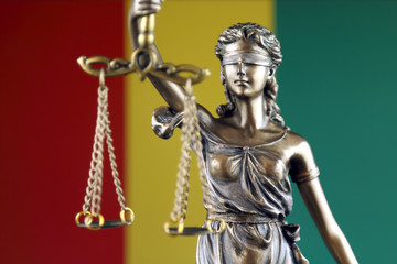 Symbol of law and justice with Guinea Flag. Close up.