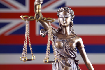Symbol of law and justice with Hawaii Flag. Close up.