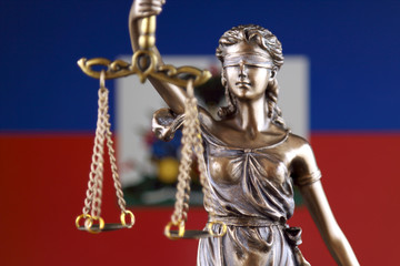 Symbol of law and justice with Haiti Flag. Close up.