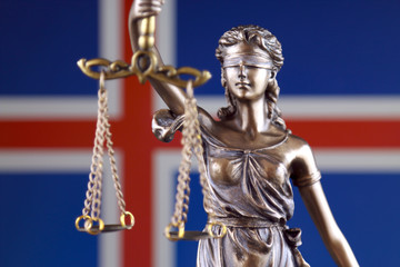 Symbol of law and justice with Iceland Flag. Close up.