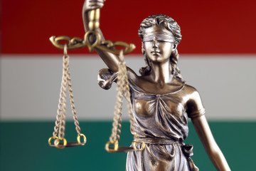 Symbol of law and justice with Hungary Flag. Close up.