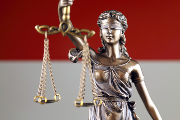 Symbol of law and justice with Indonesia Flag. Close up.