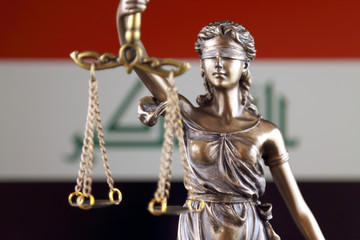 Symbol of law and justice with Iraq Flag. Close up.