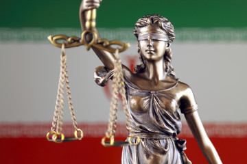 Symbol of law and justice with Iran Flag. Close up.