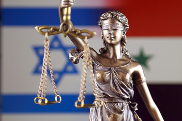 Symbol of law and justice with Israel and Syria Flag. Close up.