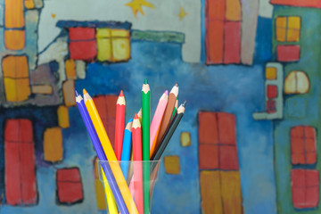 Color drawing pencils on a kids drawing background