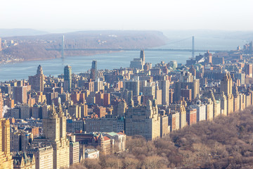 Panoramic elevated view of Central Park, Upper West Side and the George Washington Bridge with Hudson River in Fall. Manhattan, New York City, USA