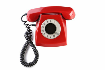 Red retro telephone isolated on a white