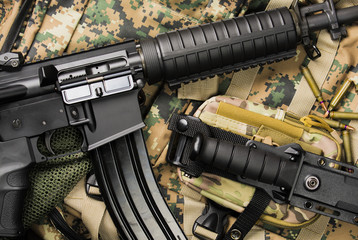 automatic rifle and knife