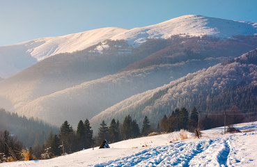 wonderful winter landscape in mountains. beautiful countryside with snow covered mountains in the distance. location Pylypets, TransCarpathian region, Ukraine