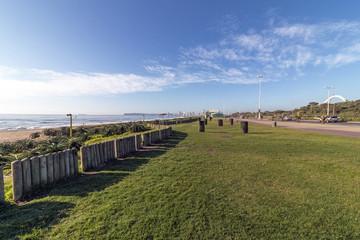 Empty Gass Verge Beachfront against City Skyline