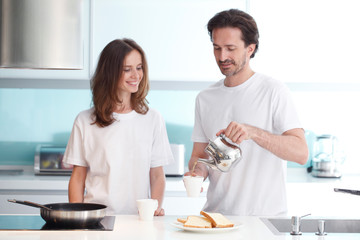 Couple cooking breakfast