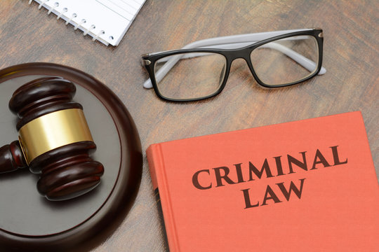 Criminal Law sign with wooden gavel and red book