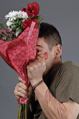 rupture amoureuse avec homme et bouquet de fleurs