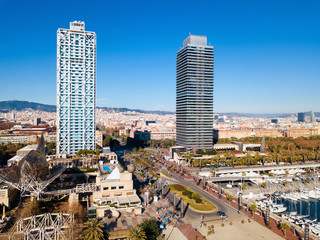 Cityscape of Barcelona with skyscrapers on embankment
