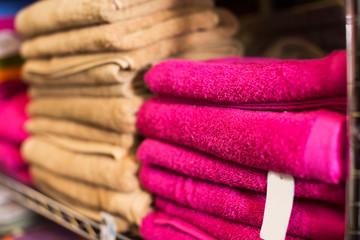 different colour towels in shop