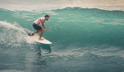 Surfer on Blue Ocean Wave, Bali, Indonesia. Riding in tube.