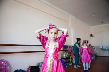 beautiful little girl in Russian national costume at the school dance