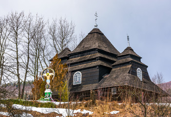 Uzhok, Ukraine - February 25, 2017: Church of the Archangel Michael - UNESCO World Heritage. old wooden building in Carpathian mountains in winter