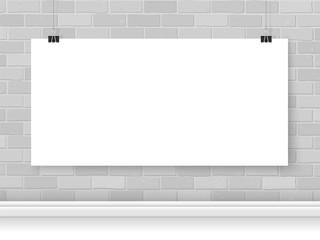 Poster paper on binder clips mockup brick wall horizontal