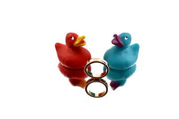 Engagement ring with rubber ducks stock images. Valentines Day concept. Colored rubber ducks. Two rubber ducks in love. Propose Day concept