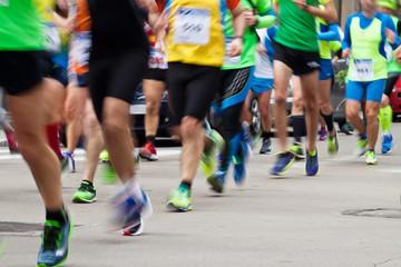 runners in city marathon (motion blur effect)