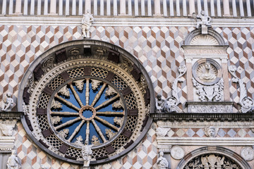 Rose window with tarsia and polychrome marble decorations on Colleoni Chapel or Cappella Colleoni church in Bergamo, Italy