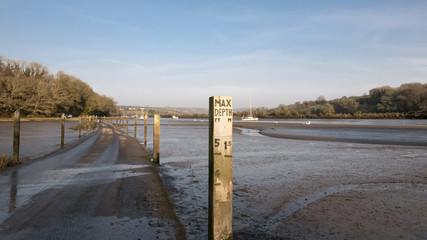 Tide marker on tidal road at Aveton Gifford