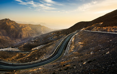 Jabal Jais mountain road at sunset. The highest mountain in the
