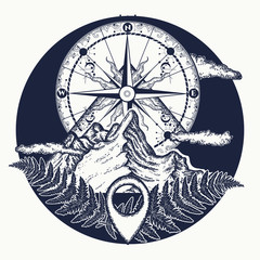 Mountain top and vintage compass tattoo and t-shirt design. Mountains and compass tattoo. Symbol of tourism, rock climbing, camping