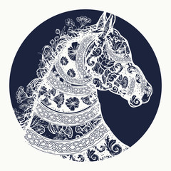 Horse tattoo and t-shirt design. Horse head in ethnic style tattoo art. Symbol of freedom, strength, grace