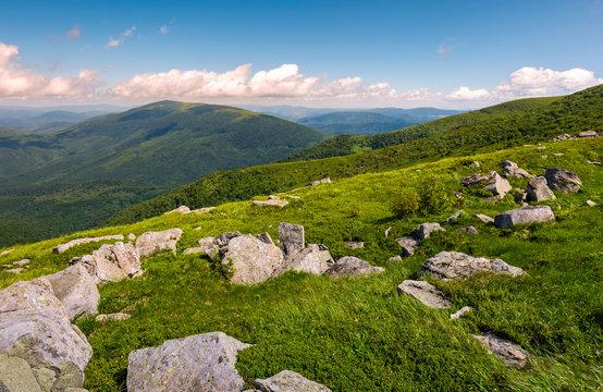 hillside of Runa mountain in summer. beautiful landscape with huge boulders in grass