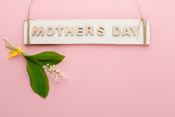 Handmade mothers day wooden card at pink background