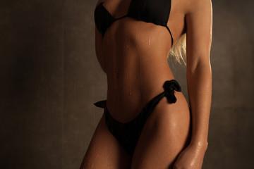 Beautiful female body on a grey background