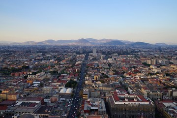 Aerial Mexico City view with mountain range in the background - clear sky