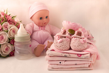 Baby clothes for newborn. In pink colors for girls. Tone pink.